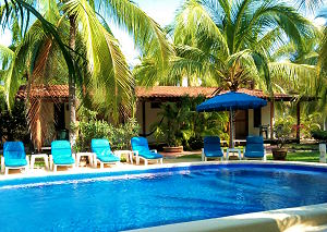 Pool and bungalows at Villa Don Manuel