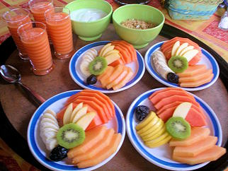 Fresh fruits and juices, yoghurt and cereals for breakfast